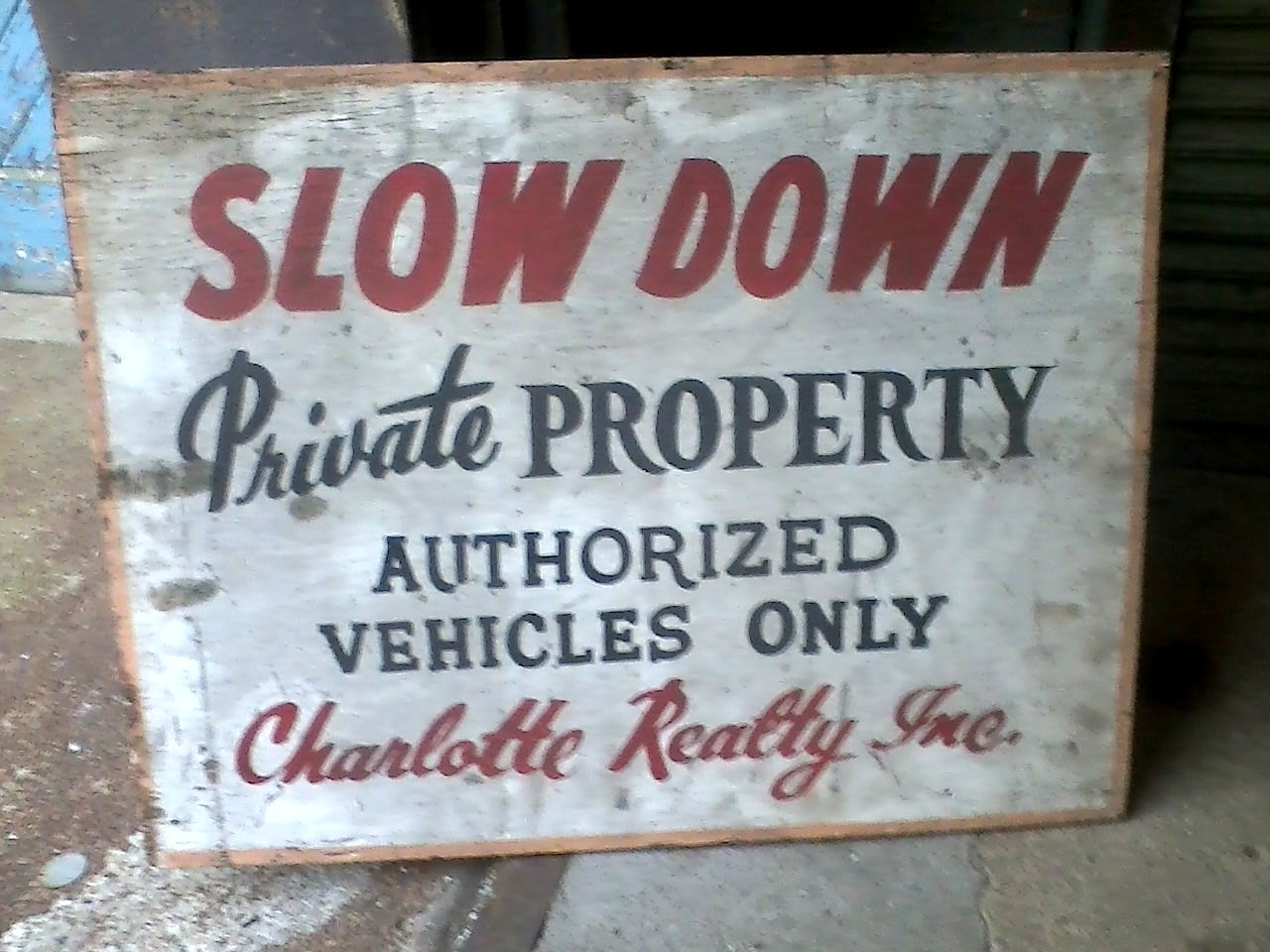 """""""SLOW DOWN / Private PROPERTY / AUTHORIZED VEHICLES ONLY / Charlotte Realty, Inc."""""""
