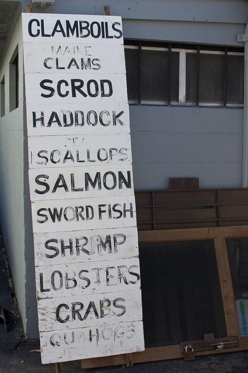 """CLAMBOILS / MAINE CLAMS / SCROD / HADDOCK / SEA SCALLOPS / SALMON / SWORD FISH / SHRIMP / LOBSTERS / CRABS / QUAHOGS / LITTLE NECKS"""