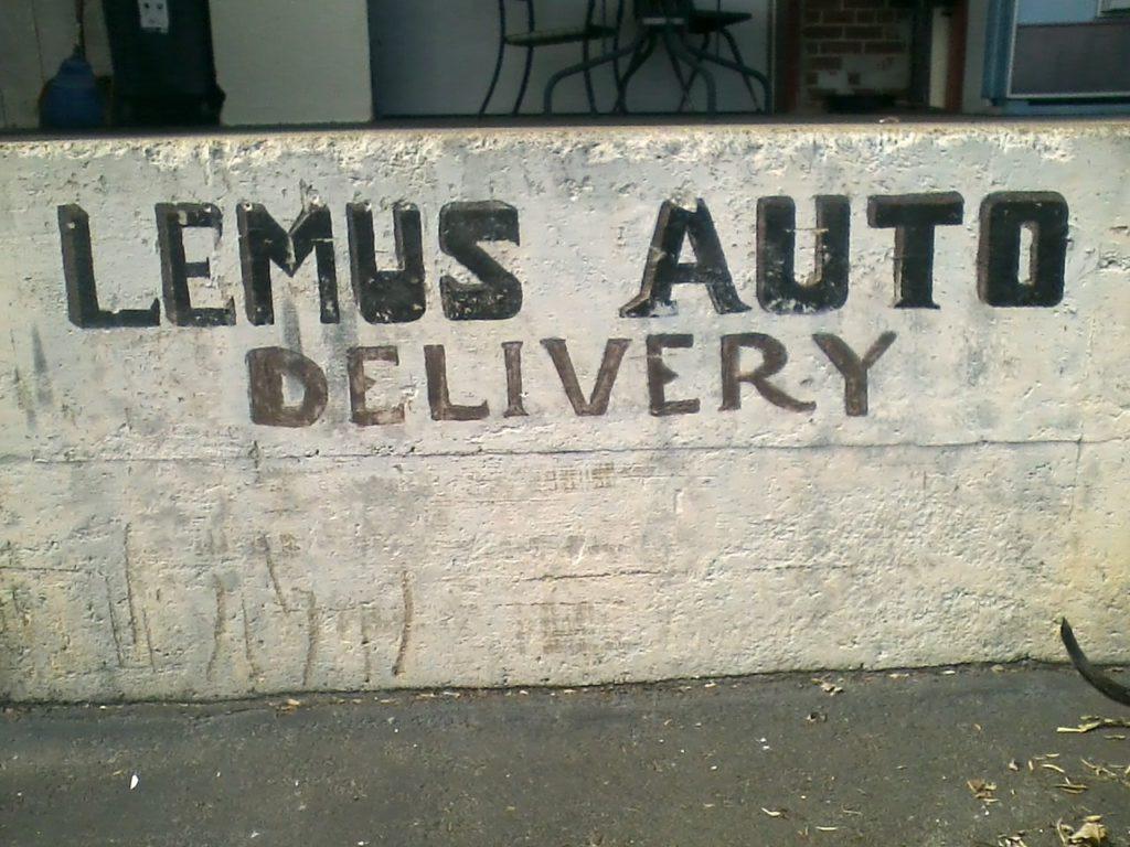 """LEMUS AUTO Delivery"" sign"